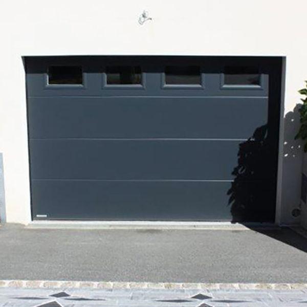 porte de garage sectionnelle en sous-sol grise anthracite