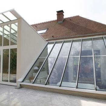 véranda toit penché vitré