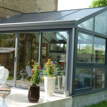 véranda entièrement vitrée effet serre de jardin